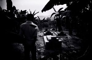 A man mourning his relatives lost to Aids in Southern Uganda (1986)