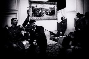 Romanian revolutionaries holding meeting in Caucescu office after his demise (1989)