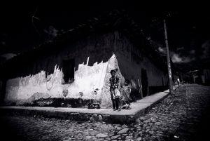 Street corner in an impoverish village of El Savador (1984)