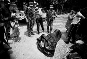 After an ambush in the mountains of El Salvador, the victims are brought back to a village (1984)