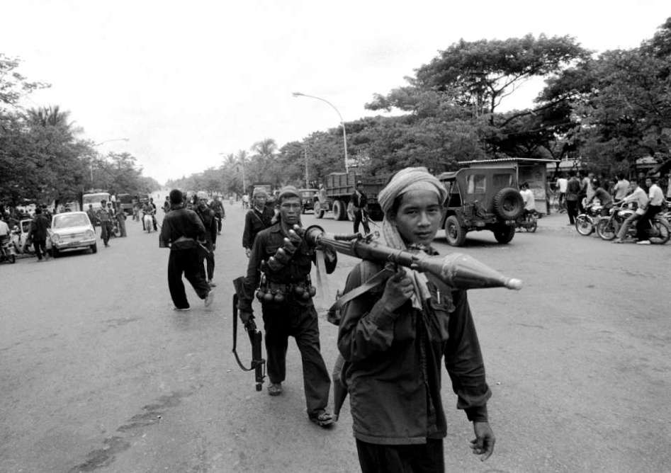 17 April 1975 The Fall of Phnom Penh. A column of Khmer Rouge guerrilla enters the city center.