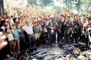 Surrendering weapons at the Fall of Phnom Penh (1975)