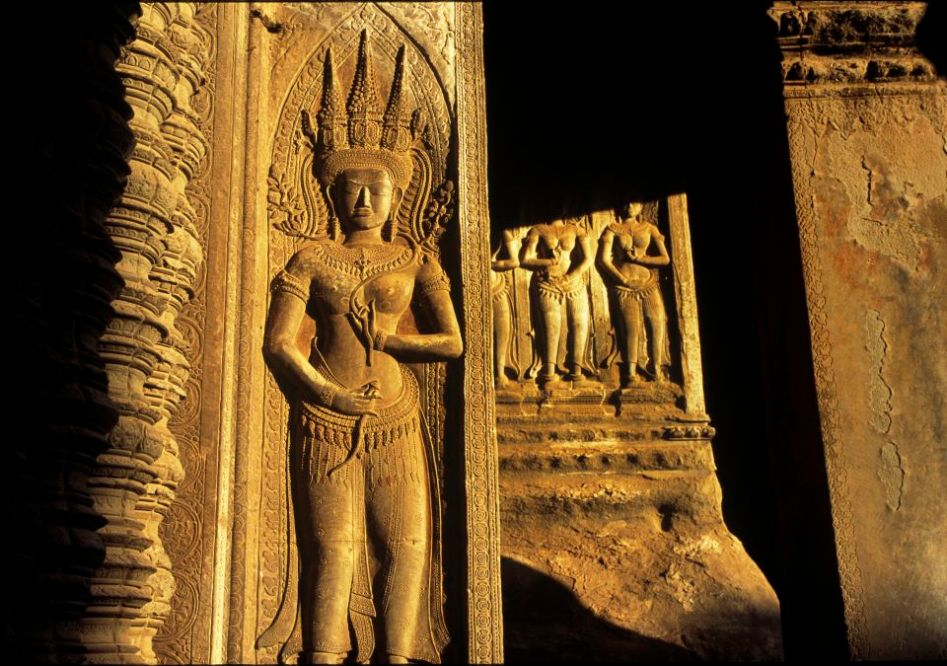 Angkor, Cambodia. The image of an apsara playing with late sun light.