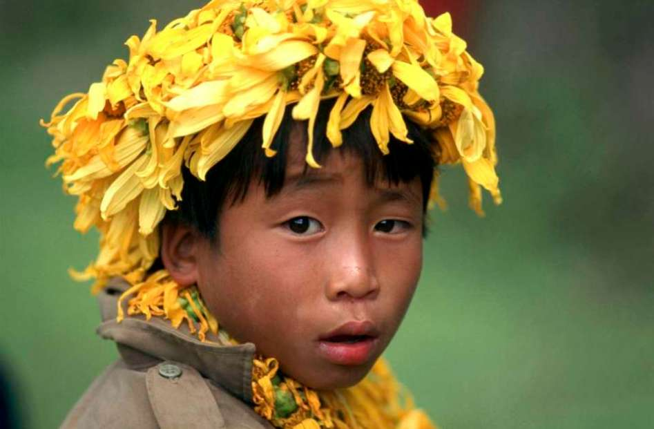 Asia, a young tribal boy at a fair in Northern Thailand.
