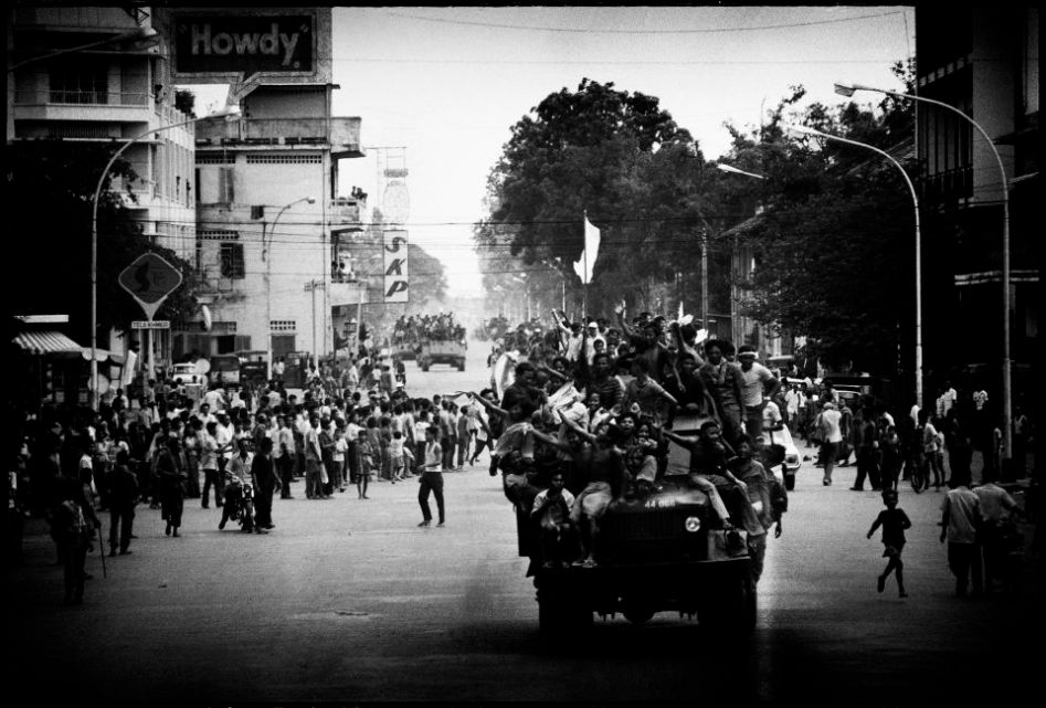 !7 April 1975 Phnom Penh Cambodia. People riding an army truck celebrated just after the Khmer entered the city.