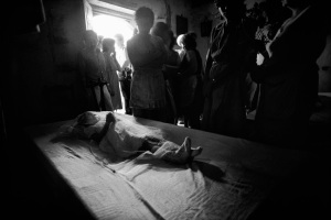 In El Salvador civil war, a young girl killed in a cross-fire is mourned at her home (1984)