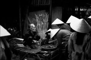 Old woman selling food stuff at a market in South Vietnam (1998)