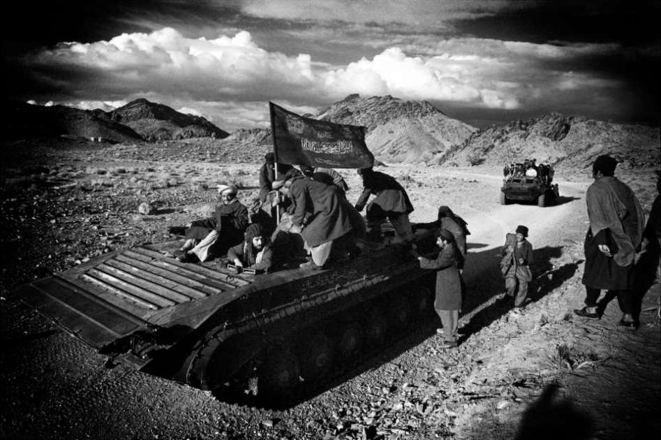 1982 Zabul Province in Afghanistan. Mudjahedeen base with capture Soviet tank.
