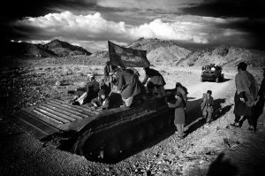 Mudjahedeen on a captured Soviet tank in SOuthern Afghanistan (1981)