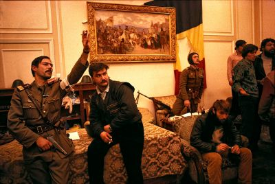 Romania-Bucarest-1989. Soldiers and civilians occupy the office of deposed president Caucescu.