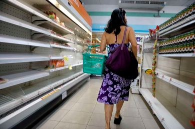 Shopping in depleted convenient store in Bangkok. Resupply of many food items has lapse in numerous shops of the city.