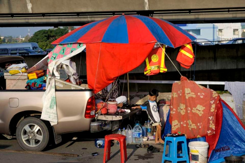 Pathum Thani is an industrial area North of Bangkok and It's main road is flooded. It's bordered on its South by the Rangsit canal along which a 20+ km sandbag wall was build to stop the water going to Bangkok. Living off the back of a pickup on the expressway.