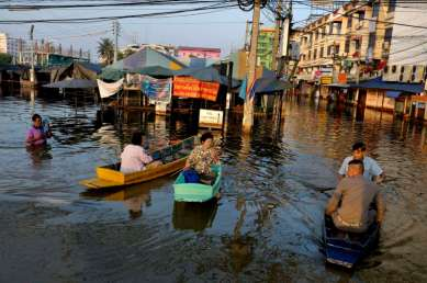 Life in the water with people moving about in their community, in short adopting a new lifestyle. Morning meet on the way to work at the end of their street where they used to get in a bus.